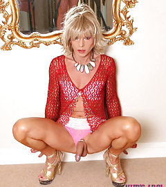Horny slut Kim is wearing a gorgeous pink mini skirt and showing her cock