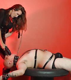 Jane is dressed alll in black and ready to teach this submissive how to get fucked.