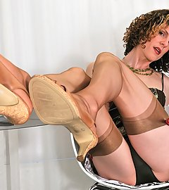 Tgirl in tan stockings displays upskirts and her big laptop surprise.