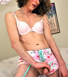 TGirl Delia wearing stockings and legwarmers using a toy vibrator.