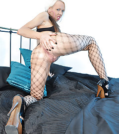 Horny blonde wearing some great fishnet stockings