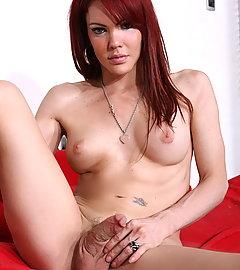 Cute redhead Valeria Wong posing her irresistible body