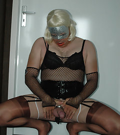 Masks and fishtnet stockings get this slutty crossdressers cock feeling nice and hard.