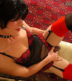 Long-legged Delia in black stockings with red cuban heels & double-seam